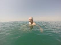 Dad floating in very deep water