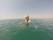 Dad floating in very deep water